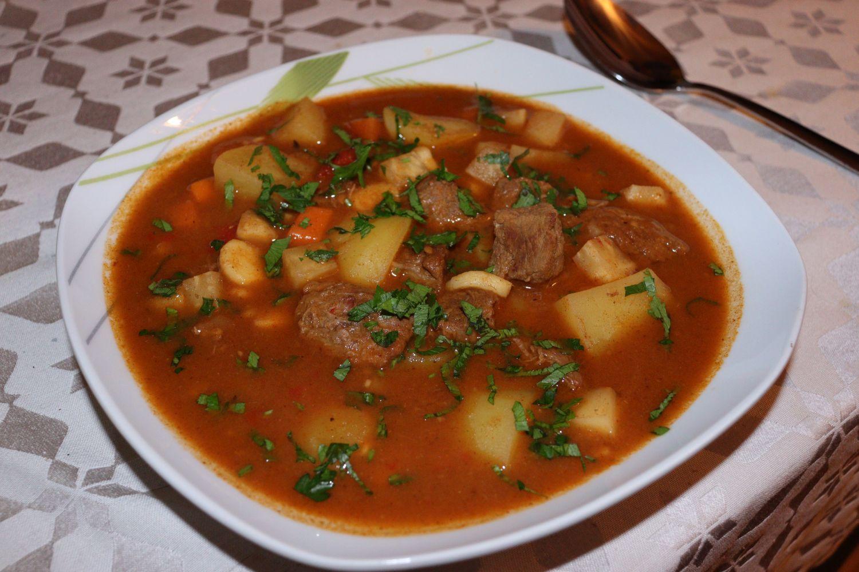 Pörkölt - Hungarian Goulash served with fresh parsley